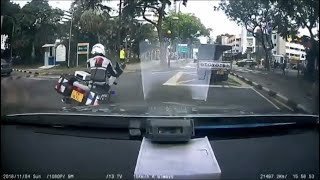 4nov2018  singapore traffic police rider clipped by camera car & got his hand injured @ hougang