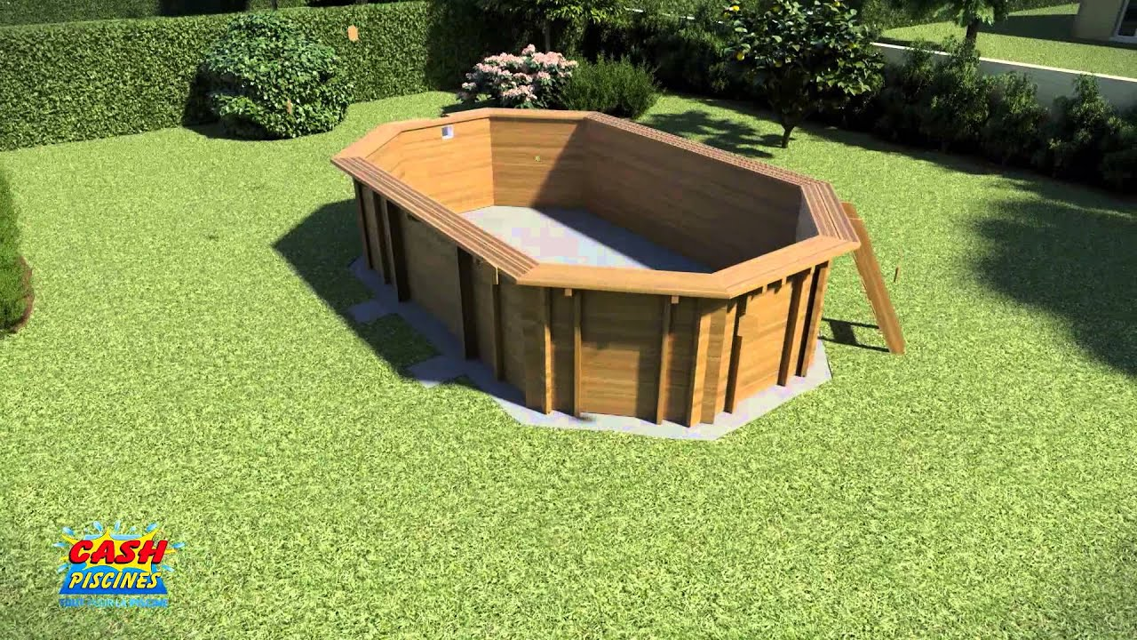 Montage piscine bois ligne bleue by cash piscines youtube for Piscine hexagonale bois