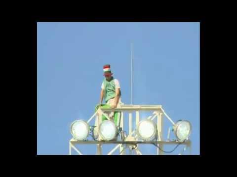 Algerian Fan climbs a light post (Algeria V Slovenia)