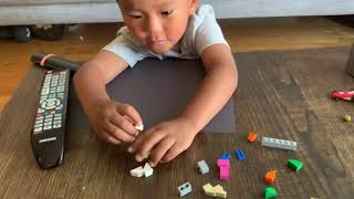Smart 3 year old kid building LEGO  heart in 5 minutes