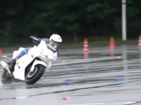 Japanese Motorcycle Police Skills on a Wet Surface