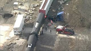TRAIN CRASH:  Truck driver tries to warn railroad that his trailer is stuck on the tracks