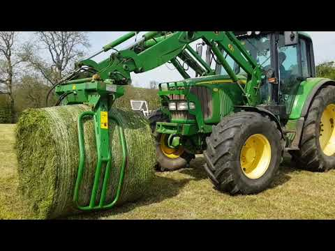 Murray Bros Round Bale, Load, Wrap And Stack 1st Cut