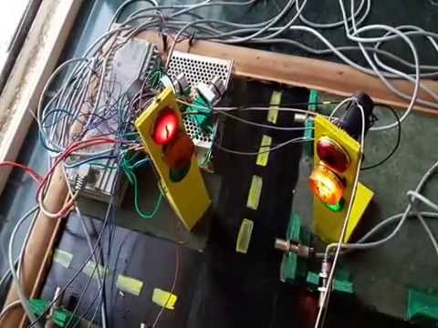 """vehicle density based traffic signal using plc and scada A model of traffic light system was developed is """"a model of traffic light system by the application of and feed a voltage signal into the plc."""