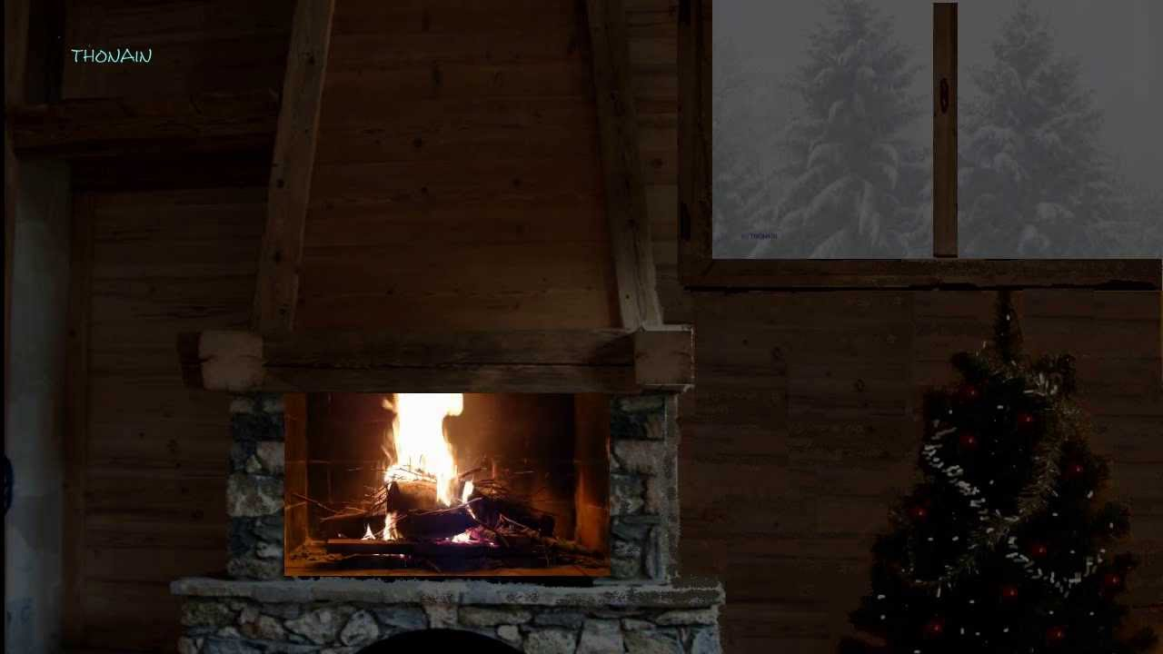 feu de cheminee dans un chalet sous la neige reveillon. Black Bedroom Furniture Sets. Home Design Ideas