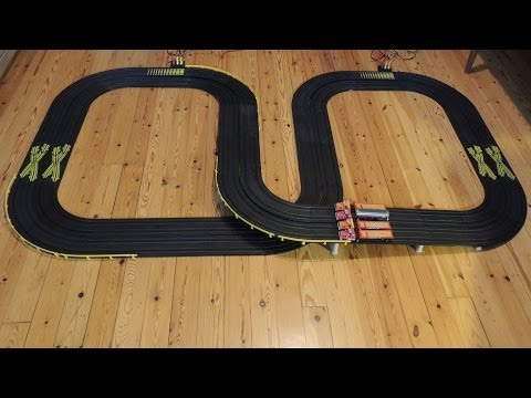 4 lane slot cars race with Tyco trucks / lorries built with Tyco 2 lane tracks