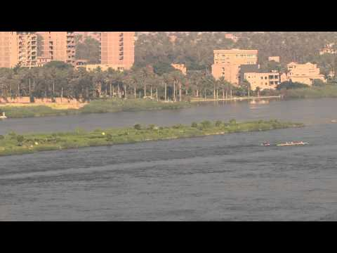 A barge on the nile river is slowing down so rowers are not harmed 5630