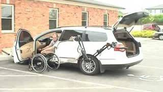 robot 2001 arm putting wheelchair into VW passat