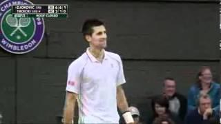 A fan gives Viktor Troicki advice on his serve against Novak Djokovic.