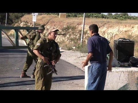 Israel tightens security in Hebron after teens' killing