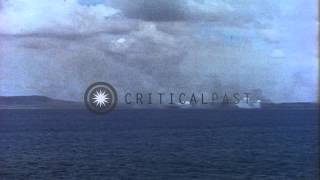 LST (Landing Ship, Tank) in transport area and bombardment at an island during in...HD Stock Footage