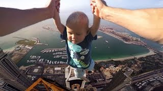 kid almost falls off building doing floor is lava challenge