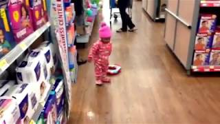 Cute baby showing off potty training skills