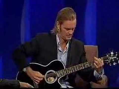 "Craig playing guitar on Dentons ""Enough Rope"""