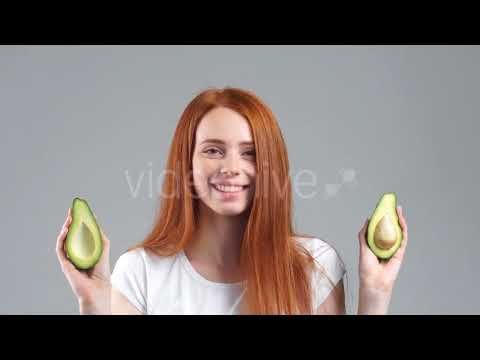 Smiling Girl Showing a Little Avocado Healthy Fruit | Stock Footage - Videohive