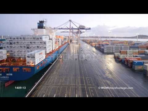 Time-lapse of container ship arriving and being unloaded / Auckland, New Zealand