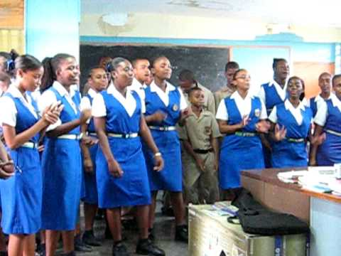 innswood men Ka bamskilly along with the school's head boy 204-2015 and two female students present a song made specially for the institution of tacius golding high blas.