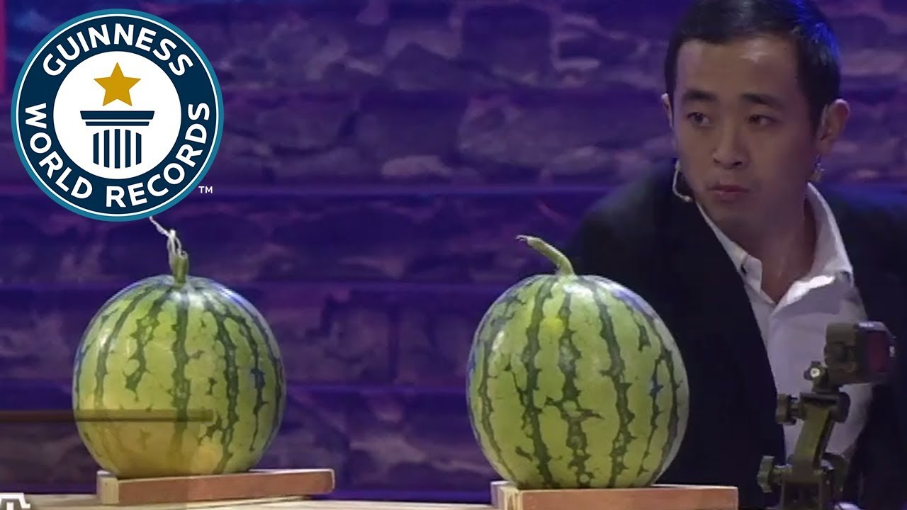 Most playing cards thrown into watermelons in one minute - Guinness World Records
