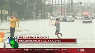 RAW VIDEO: Man catches fish with hands on flooded Hillsborough Ave. & Sawyer