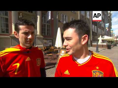 SPANISH REFLECT ON BAILOUT NEWS; MADRID MASS, FANS IN GDANSK