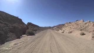 From Highway 78 East, turn left on Buttes Pass Road. The sand track...
