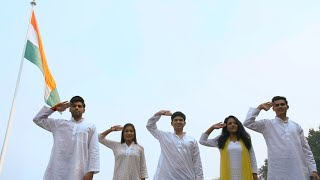 Happy young teenagers saluting Indian national flag - Independence/Republic Day