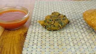 Pan shot of delicious Indian starters placed on a kitchen mat - fried food concept