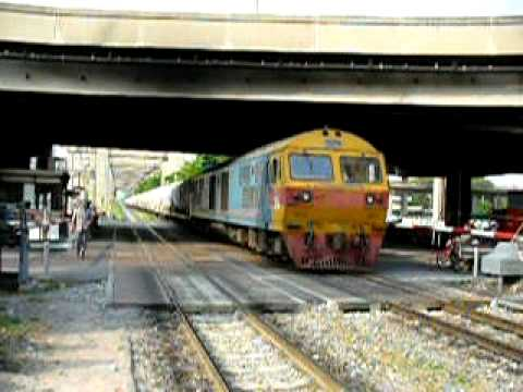 Cement train passing Bangkhen level crossing. (Thailand)