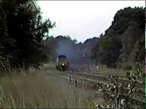 Class 47 heads a lengthy parcels train west of Twyford towards Paddington. 1985.