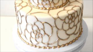 Wedding Cake Made With Fondant Icing And Gold Piping