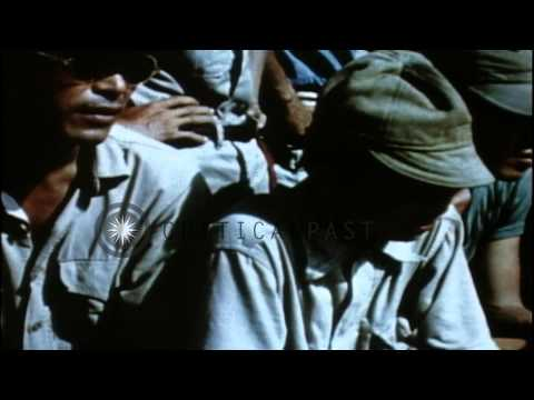 US personnel march Japanese personnel and take care of civilians during the Pacif...HD Stock Footage