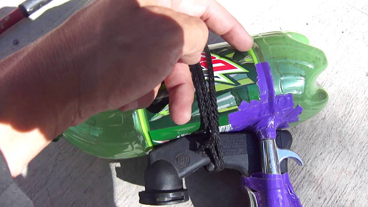 Home made quick and easy mini sand-blaster made out of a mountain-dew  bottle and some duck tape