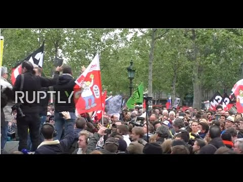 LIVE: Activists in Paris rally against country's new president