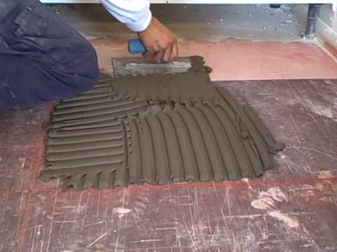 How to use a trowel to spread adhesive - YouTube