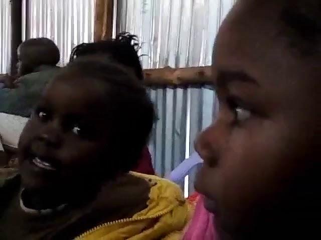 Brother Jackson Teaching Children Kibera Slum Kenya