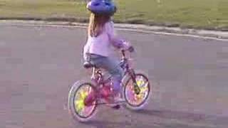 Amber riding her bike for the first time on 2 wheels