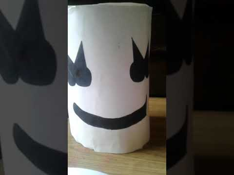 Making marshmello helmet with paper and cardboard
