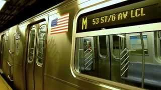 R160 E, F, M, and R46 R trains at Queens Plaza
