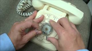 How to remove the dial from a rotary phone