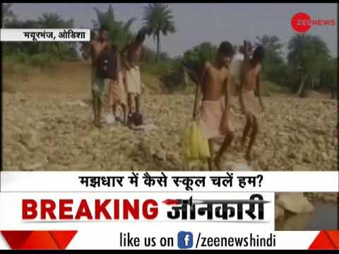 Students cross river to reach school in Odisha