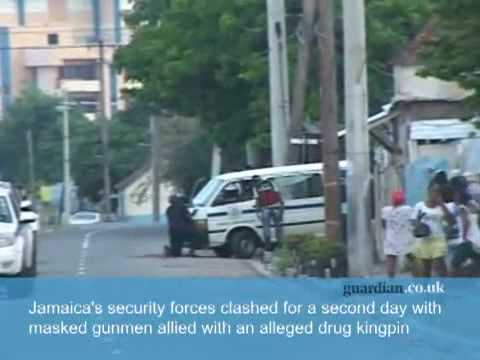 RAW FOOTAGE - TIVOLI GARDEN'S ASSUALT DEEPENS, CASUALTIES RISE in Kingston Jamaica