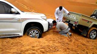 Toyota Land Cruiser stuck in desert sand