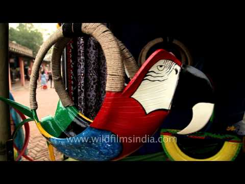 Recycled tyres turned into pots for sale at Dilli Haat, Delhi