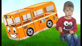 Kids play with bus and car