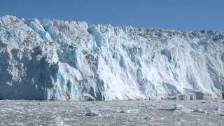 an ice fall of eqip glacier greenland 12 aug 2012