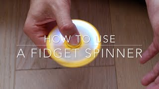 How to use a fidget spinner