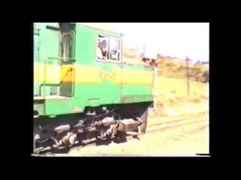 Green & Yellow African Diesel Train #506 in Malawi Non existent Road Level Crossing filmed 2000