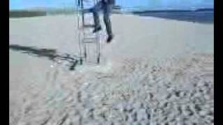 Boy Jumps And Falls Off Lifeguard Chair