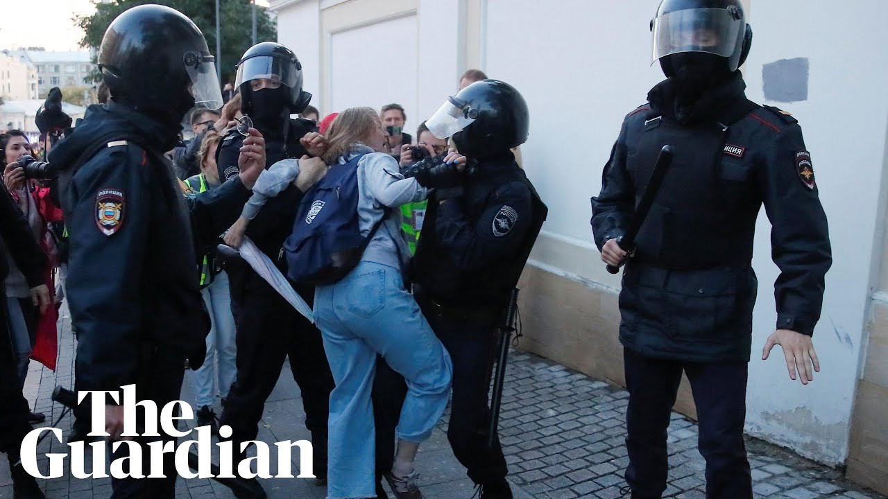 Riot police in Russia punch a women in stomach during a protest for free elections