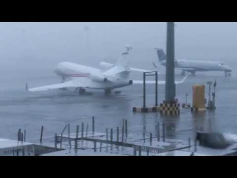 Typhoon Hong Kong and Macau - luxury private airplane swept by damaging winds